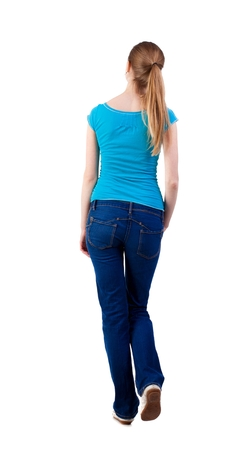 back view of walking  woman  in   jeans and shirt. beautiful blonde girl in motion. looking at something on top of the girl went off.  backside view of person.  Rear view people collection. Isolated over white background.