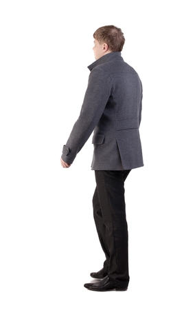 defile: Back view of going  handsome business man in coat.  walking young businessman .defile male fashion model in autumn clothes.  Rear view people collection.  backside view of person.  Isolated over white background.