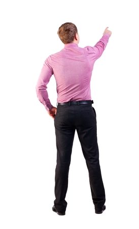 demanded: Back view of  pointing young business men in  red shirt. blonde businessman  gesture. Rear view people collection.  backside view of person.  Isolated over white background. businessman with a sports figure demanded indicates something Stock Photo