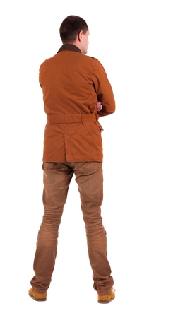 standing up: Back view of stylishly dressed man in a brown jackett  looking up.   Standing young guy in jeans and  jacket. Rear view people collection.  backside view of person.  Isolated over white background.