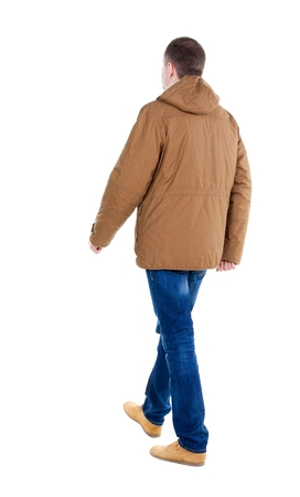 treading: Back view of going  handsome man in brown parka. walking young guy . Rear view people collection.  backside view of person.  Isolated over white background.