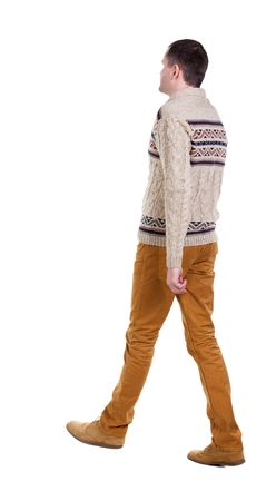 treading: Back view of going  handsome man in jeans and warm sweater.  walking young guy . Rear view people collection.  backside view of person.  Isolated over white background.