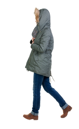 white winter: back view of walking  woman in winter jacket with hood. beautiful brunette girl in motion.  backside view of person.  Rear view people collection. Isolated over white background.