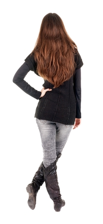 back view of standing young beautiful  woman.  blonde girl in jeans and sweater watching;. Rear view people collection.  backside view of person.  Isolated over white background. Stock Photo