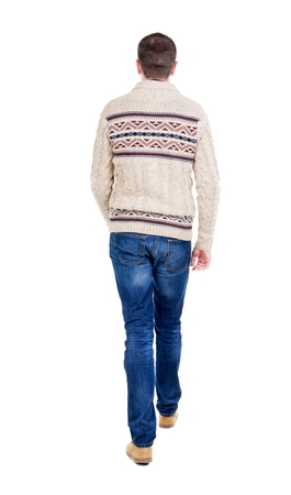 treading: Back view of going  handsome man in a knitted sweater. walking young guy . Rear view people collection.  backside view of person.  Isolated over white background. Stock Photo