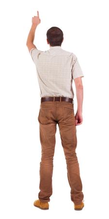 Vue arrière de pointer les jeunes hommes en chemise et en jeans. Geste de jeune gars. Vue arrière collection de personnes. vue arrière de la personne. Isolé sur fond blanc. Banque d'images