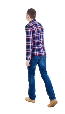 treading: Back view of going  handsome man in checkered shirt. walking young guy . Rear view people collection.  backside view of person.  Isolated over white background. Stock Photo
