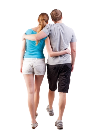 treading: Back view of going young couple (man and woman). walking beautiful friendly girl and guy in shorts together. Rear view people collection. backside view of person.  Isolated over white background. heterosexual friends go hand in hand looking up