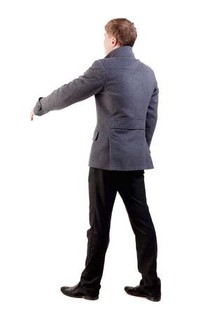 reaches: back view of businessman in coat reaches out to shake hands. Rear view people collection. backside view of person. Isolated over white background. Stock Photo