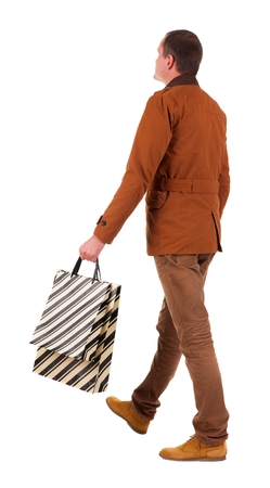 treading: Back view of going  handsome man with shopping bags.  walking young guy is shopping. Rear view people collection.  backside view of person.  Isolated over white background.