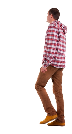 treading: Back view of going  guy in a plaid shirt with hood.  walking young guy in jeans and  jacket. Rear view people collection.  backside view of person.  Isolated over white background.