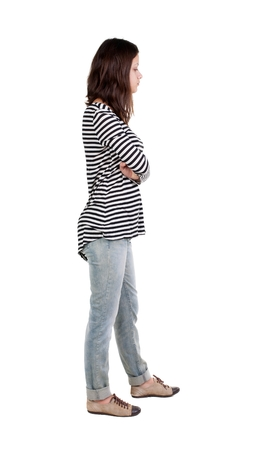 frock: back view of standing young beautiful  brunette woman in striped frock. girl  watching. Rear view people collection.  backside view of person.  Isolated over white background. Stock Photo