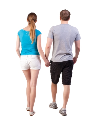 Back view of going young couple (man and woman). walking beautiful friendly girl and guy in shorts together. Rear view people collection. backside view of person.  Isolated over white background. Tourists walk somewhere