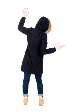 parka: Back view woman in winter jacket  Balances waving his arms.   Standing young girl in parka. Rear view people collection.  backside view of person.  Isolated over white background.