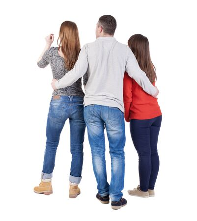 back view of man: Back view of three friends  (woman and man). A guy in a gray jacket hugging two friends.  backside view of person.  Isolated over white background.