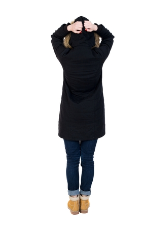 parka: Back view of shocked woman in parka. upset young girl. Rear view people collection.  backside view of person.  Isolated over white background. Girl in a black winter jacket with a hood terrified her head in her hands.