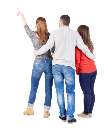 loe: Back view of three friends pointing. group of people watching somewhere. Rear view people collection.  backside view of person.  Isolated over white background.