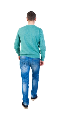 treading: Back view of going  handsome man in jeans and a shirt.  walking young guy . Rear view people collection.  backside view of person.  Isolated over white background. The guy in the green jacket went off.