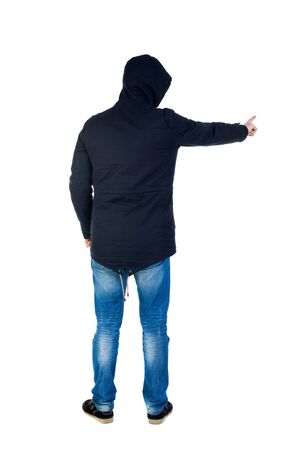 pulled over: Back view of  pointing young men in parka. Young guy  gesture. Rear view people collection.  backside view of person.  Isolated over white background. Man in warm jacket hood pulled on his head is and points to the left.