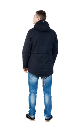 Back view of handsome man in winter jacket  looking up.   Standing young guy in parka. Rear view people collection.  backside view of person.  Isolated over white background. man in jacket looking to the right