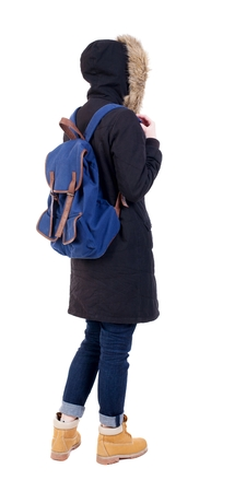 Back view woman in winter jacket with a backpack  looking up.   Standing young girl in parka. Rear view people collection.  backside view of person.  Isolated over white background. photo