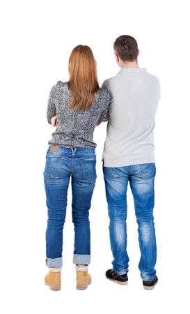 Back view of young embracing couple (man and woman) hug and look into the distance. beautiful friendly girl and guy together. Rear view people collection.  backside view of person.  Isolated over white background. Arms crossed man and woman standing side  photo