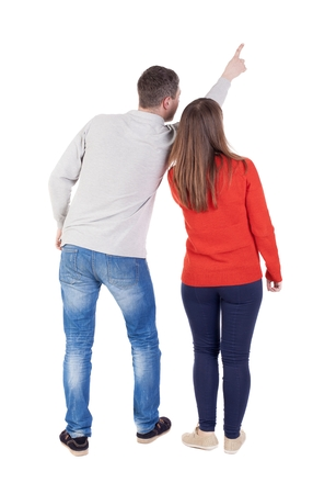 man rear view: young couple pointing at wal Back view  (woman and man). Rear view people collection.  backside view of person.  Isolated over white background. Stock Photo