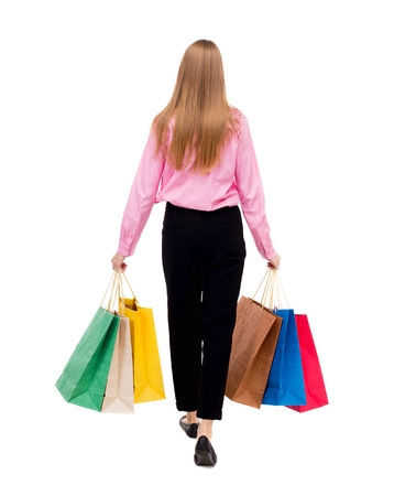 back view of going  woman  with shopping bags . beautiful girl in motion.  backside view of person.  Rear view people collection. Isolated over white background. Woman businessman went off with a lot of bags.