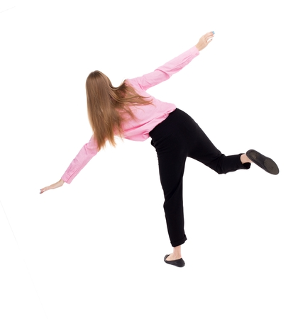 stumble: Balancing young business woman.  or dodge falling woman. Rear view people collection.  backside view of person.  Isolated over white background. The girl office worker in black trousers trying not to fall. Stock Photo