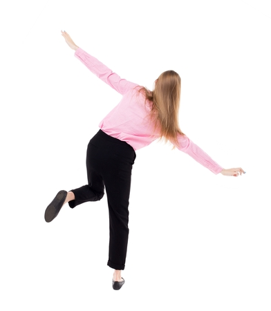 stumble: Balancing young business woman.  or dodge falling woman. Rear view people collection.  backside view of person.  Isolated over white background. The girl office worker in black trousers shows the plane.