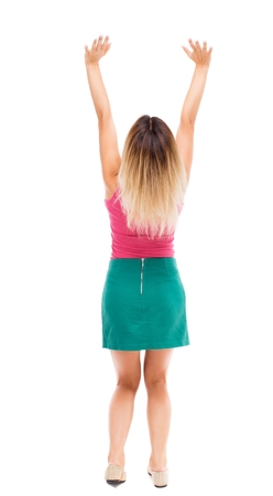 severity: Back view of beautiful woman welcomes. Young teenager girl in jeans hand waving from. Rear view  people collection.  backside view of person.  Isolated over white background. Blond girl in a green skirt holding of a severity.
