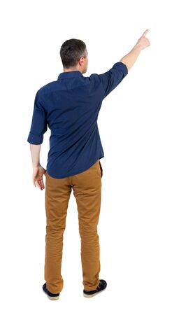 his shirt sleeves: Back view of pointing business man.  Rear view people collection.  backside view of person.  Isolated over white background. a man in a blue shirt with the sleeves rolled up showing up with his right hand. Stock Photo