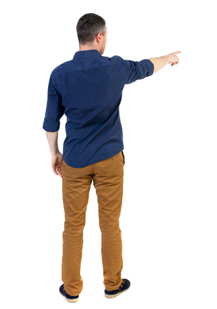 Back view of pointing business man.  Rear view people collection.  backside view of person.  Isolated over white background. a man in a blue shirt with the sleeves rolled up showing the right hand side. Stock Photo