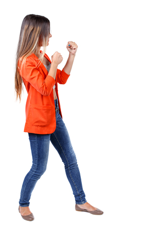 wimp: back view of woman funny fights waving his arms and legs. Rear view people collection. backside view of person.  Isolated over white background.  student in a red jacket in a boxing rack.