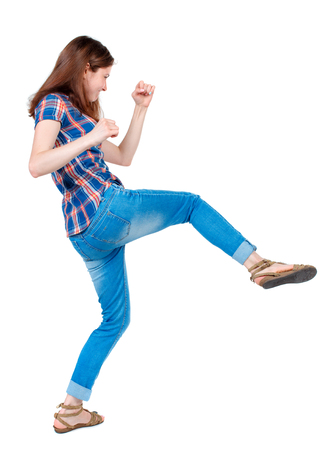wimp: back view of woman funny fights waving his arms and legs. Rear view people collection. backside view of person.  Isolated over white background. Girl in plaid shirt has a foot.