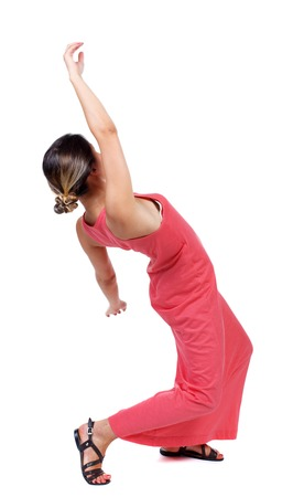 Balancing young woman.  or dodge falling woman. Rear view people collection.  backside view of person.  Isolated over white background. A slender woman in a long red dress falls on his back.