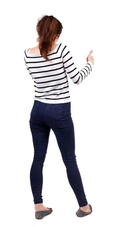 Back view of  woman thumbs up. Rear view people collection. backside view of person. Isolated over white background. Girl in a striped sweater showing thumb up. Stock Photo