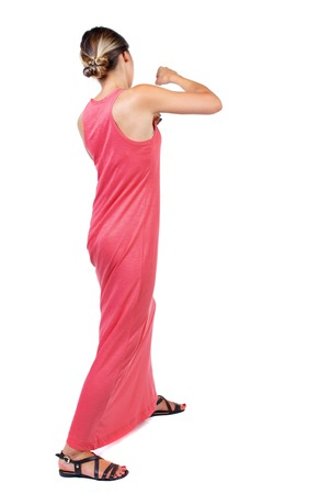 wimp: skinny woman funny fights waving his arms and legs. Isolated over white background. A slender woman in a long red dress fights.