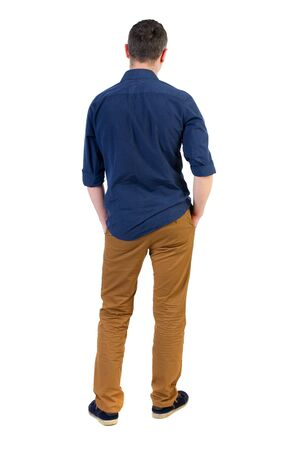 his shirt sleeves: Back view of man . Standing young guy. Rear view people collection.  backside view of person.  Isolated over white background. a man in a blue shirt with the sleeves rolled up, standing with his hands in his pocket, and looks into the distance.