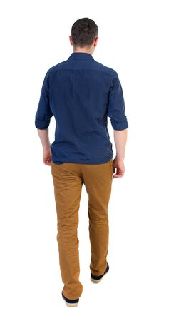 treading: Back view of going  handsome man. walking young guy . Rear view people collection.  backside view of person.  Isolated over white background. a man in a blue shirt with the sleeves rolled out into the distance Stock Photo