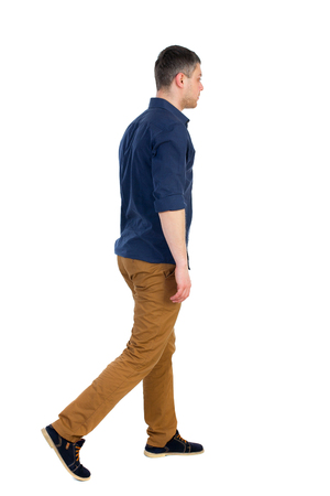 rolled up sleeves: Back view of going  handsome man. walking young guy . Rear view people collection.  backside view of person.  Isolated over white background. a man in a blue shirt with the sleeves rolled up, sad is right.