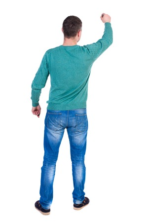 back view of writing business man. Rear view people collection.  backside view of person. Isolated over white background. A man in a green jacket and jeans marker writing on the wall.