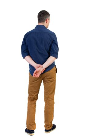 rolled up sleeves: Back view of man . Standing young guy. Rear view people collection.  backside view of person.  Isolated over white background. a man in a blue shirt with the sleeves rolled up is looking pensively into the distance. Stock Photo