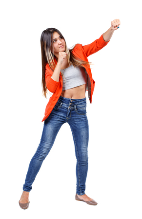 back view of woman funny fights waving his arms and legs. Rear view people collection. backside view of person.  Isolated over white background. girl in a red jacket standing face to us and hand strikes.