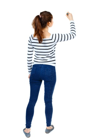 back view of writing beautiful woman. Rear view people collection.  backside view of person. Isolated over white background. Girl in a striped sweater thoughtfully draws a pen. Banque d'images