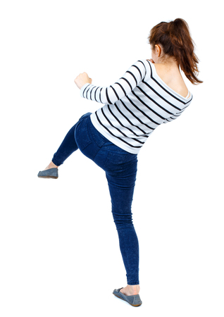 wimp: back view of woman funny fights waving his arms and legs. Rear view people collection. backside view of person.  Isolated over white background. Girl in a striped sweater makes striking out kikbkosinga. Stock Photo