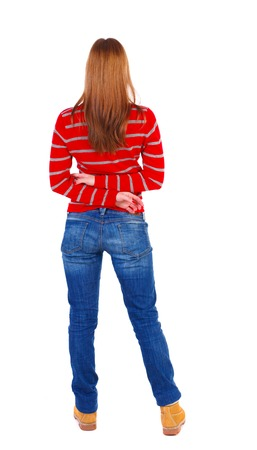 back view of standing young beautiful  woman.  girl  watching. Rear view people collection.  backside view of person. The blonde in a red striped sweater standing with hands clasped behind his back.