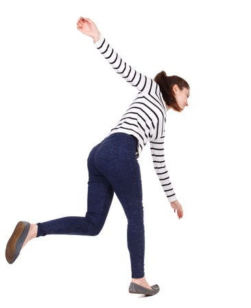 slipped: Balancing young woman.  or dodge falling woman. Rear view people collection.  backside view of person.  Isolated over white background. Girl in a striped sweater slipped down.