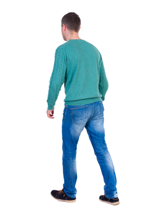 Back view of going  handsome man. walking young guy . Rear view people collection.  backside view of person.  Isolated over white background. A man in a green jacket leaves left.