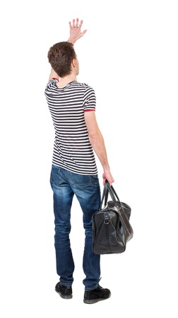 striped vest: back view of  man with a bag waving in greeting.  backside view of person.  Rear view people collection. Isolated over white background. Curly boy in a striped vest holding a bag in his hand and waving goodbye.